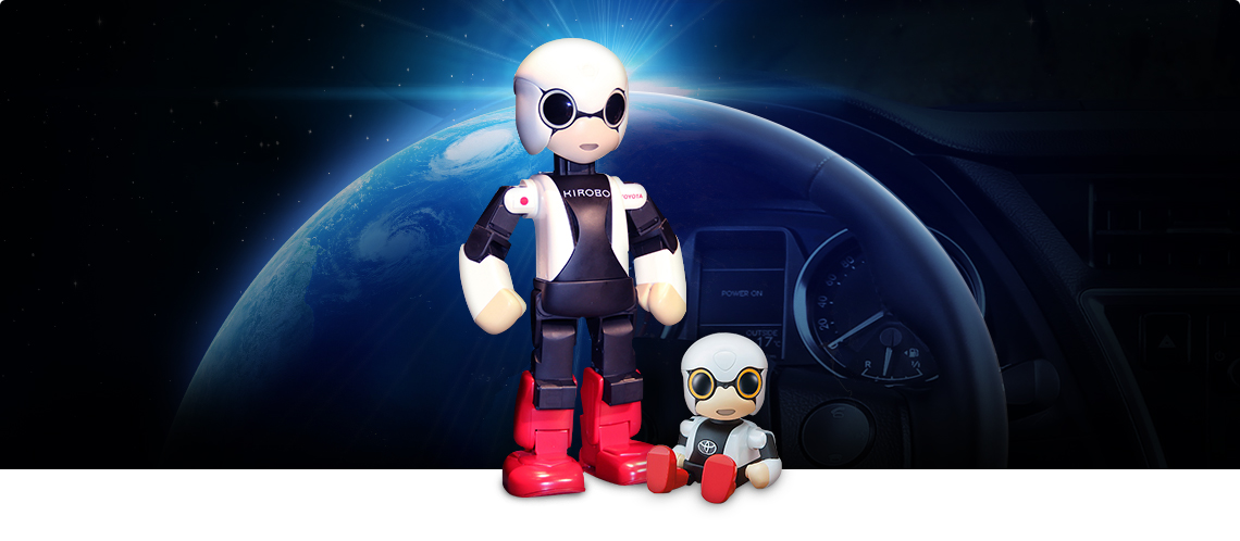 Kirobo and Kirobo Mini in front of steering wheel
