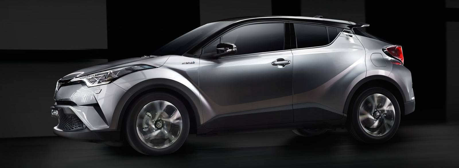 Toyota C-HR, exterior Silver, side view, black background, close-up view.