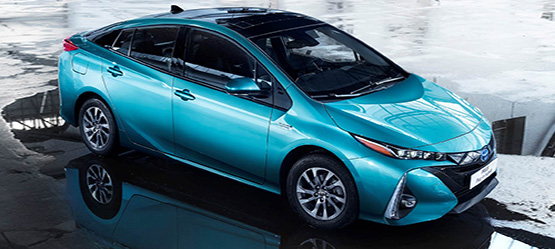Toyota Prius Plug-in, exterior front side view, aqua marine colour on wet concrete