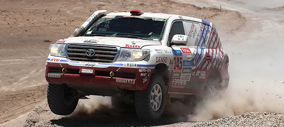 Toyota Land Cruiser, exterior sports car, front side view, driving rapidly through a desert, daytime background