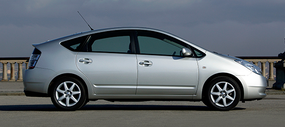 Toyota Prius, exterior Silver, side view, daytime outdoors background.