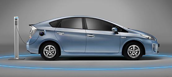 Toyota Prius, exterior Blue, side view, vehicle being electrically charged, grey background.