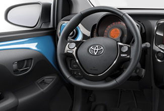 Toyota Aygo, interior, leather steering wheel, control panel, glove compartment, dark grey & blue colour scheme