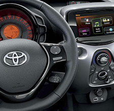 Toyota Aygo, interior, leather steering wheel, control panel & glove compartment.