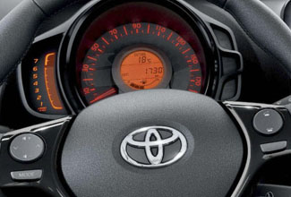 Toyota Aygo, interior, leather steering wheel & control panel close up