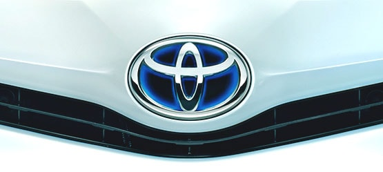 Toyota Hybrid, exterior White, close-up of front of bonnet with brand logo on display.