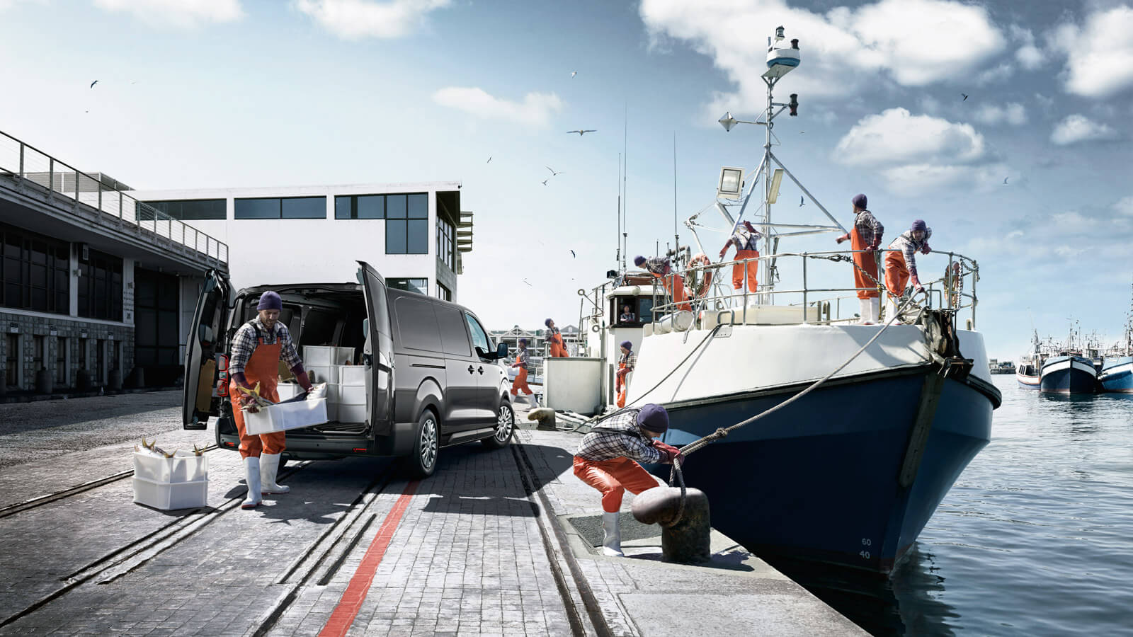 Toyota Proace, men unloading fish on harbour, fishing boat, harbour daytime background.